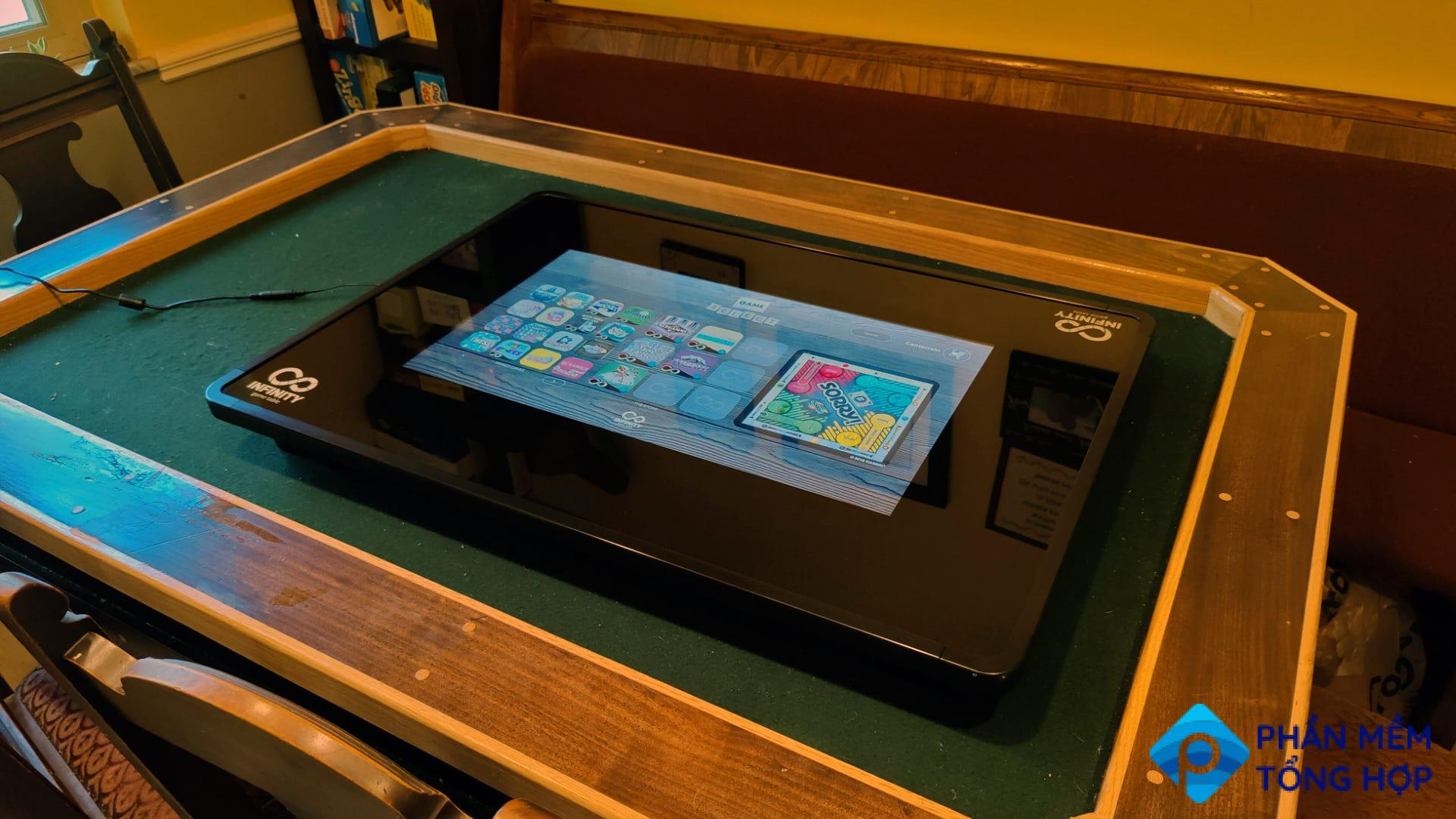 An Infinity Game Table inset into a board game table.