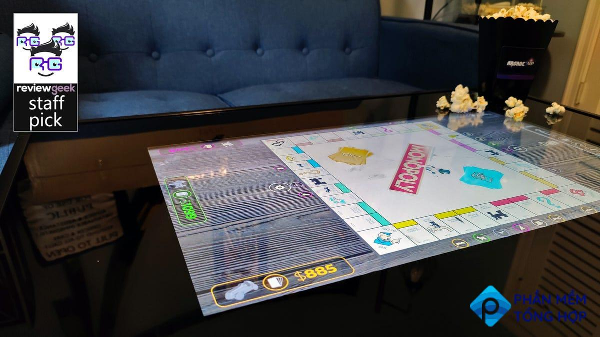 A digital copy of 'Monopoly' on a giant tablet coffee table.