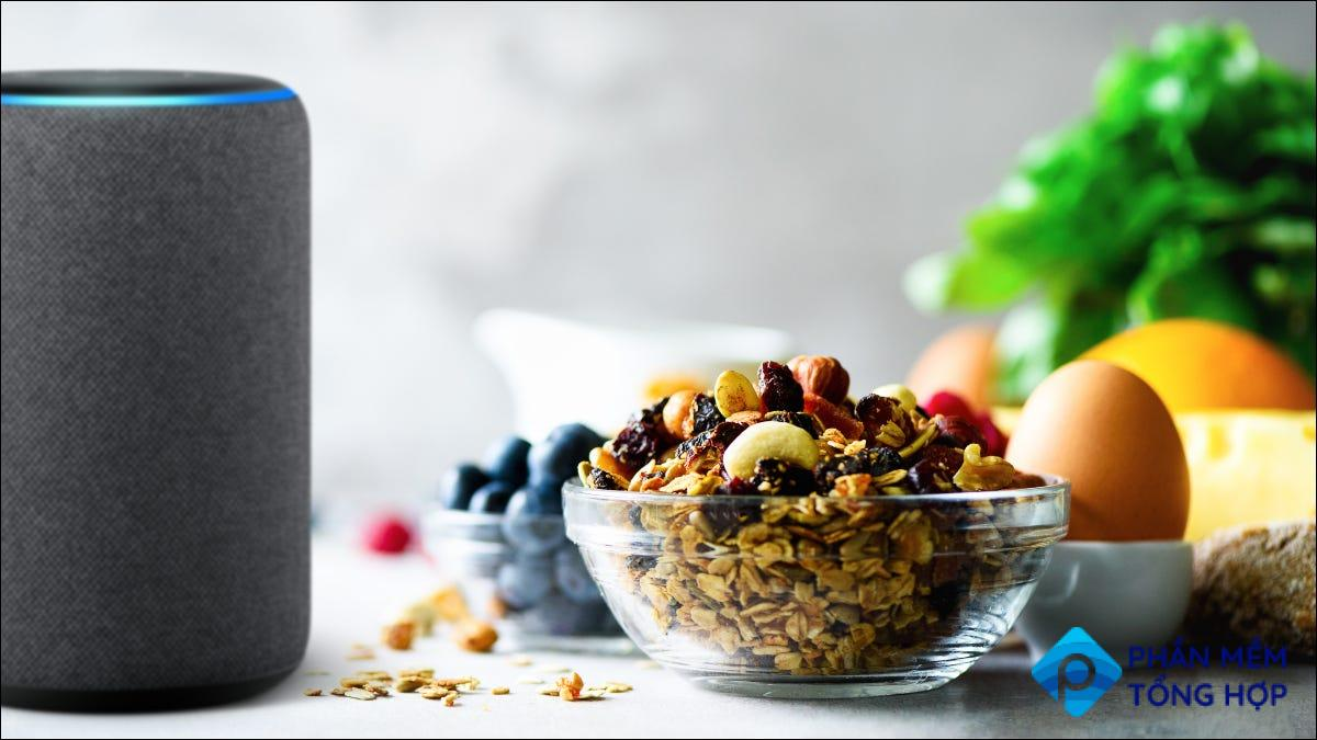 Alexa device with groceries on table.