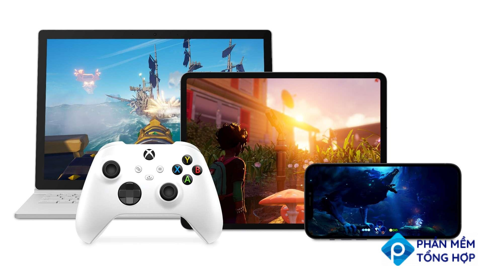 An Xbox controller in front of a laptop, iPad, and Android phone all playing Xbox games