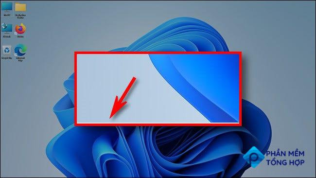 In Windows 11, when the taskbar is hidden, you'll see a tiny line at the bottom of your screen.