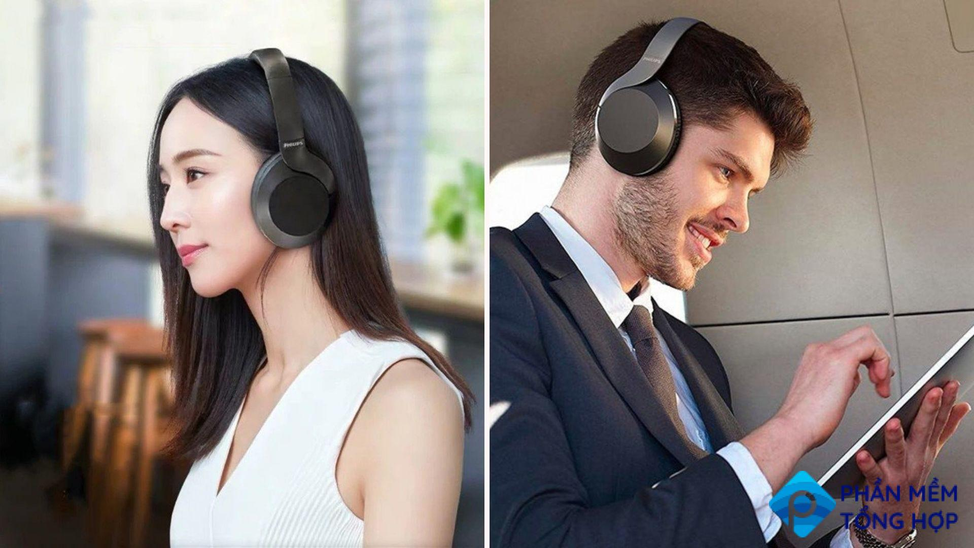 A woman and a man wearing black headphones
