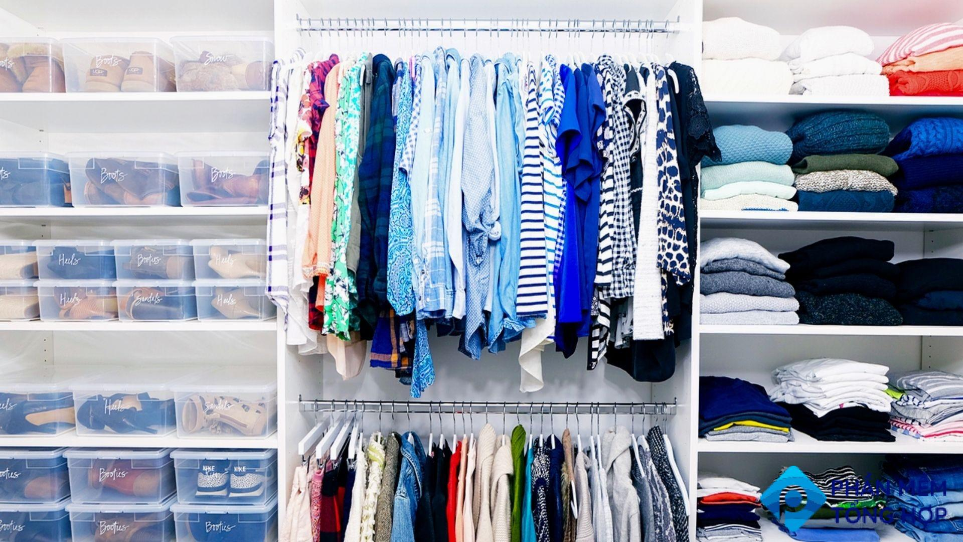A tidy closet with clear containers and color-coordinated clothes.
