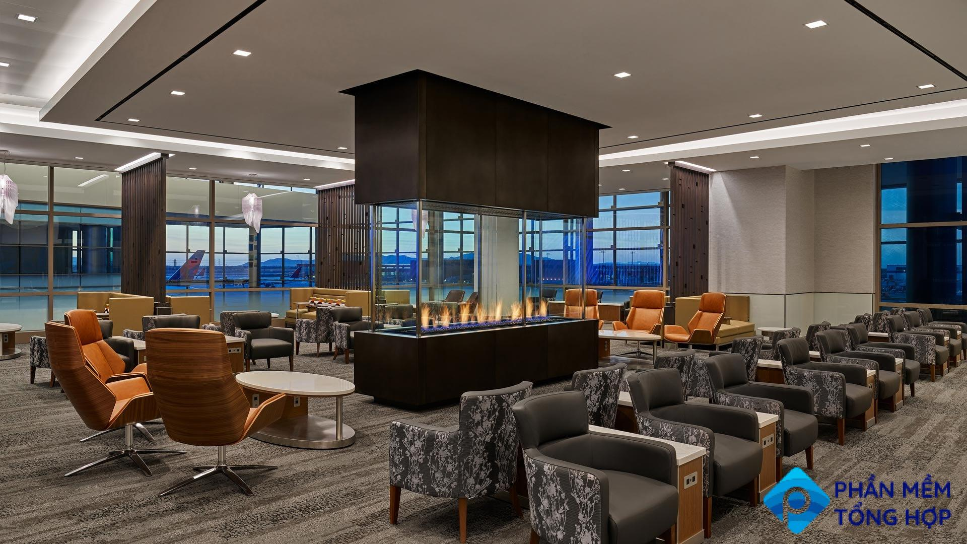 A well appointed airport lounge with comfortable seating and a fireplace.