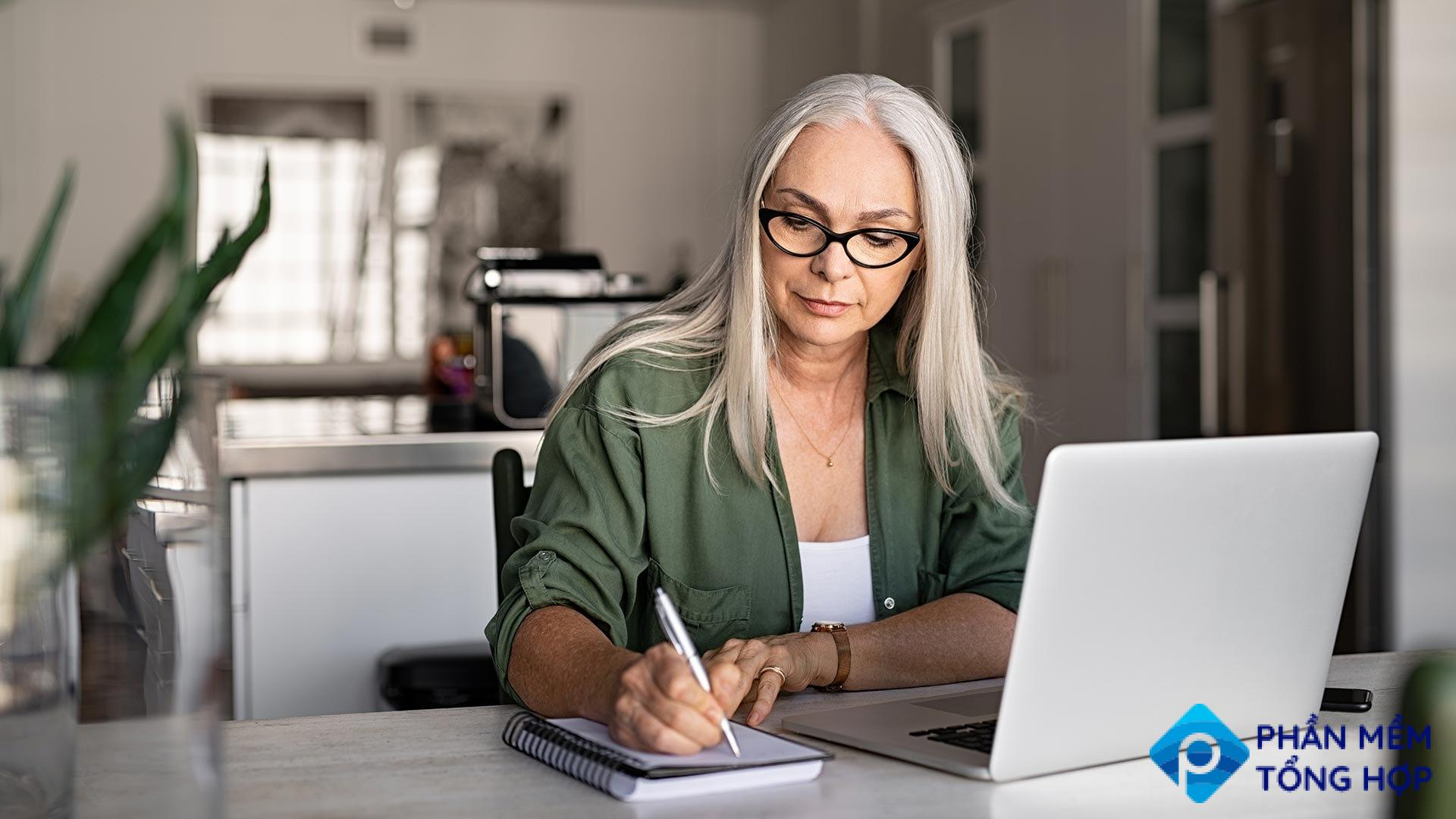 A woman writing down a checklist to help her focus.