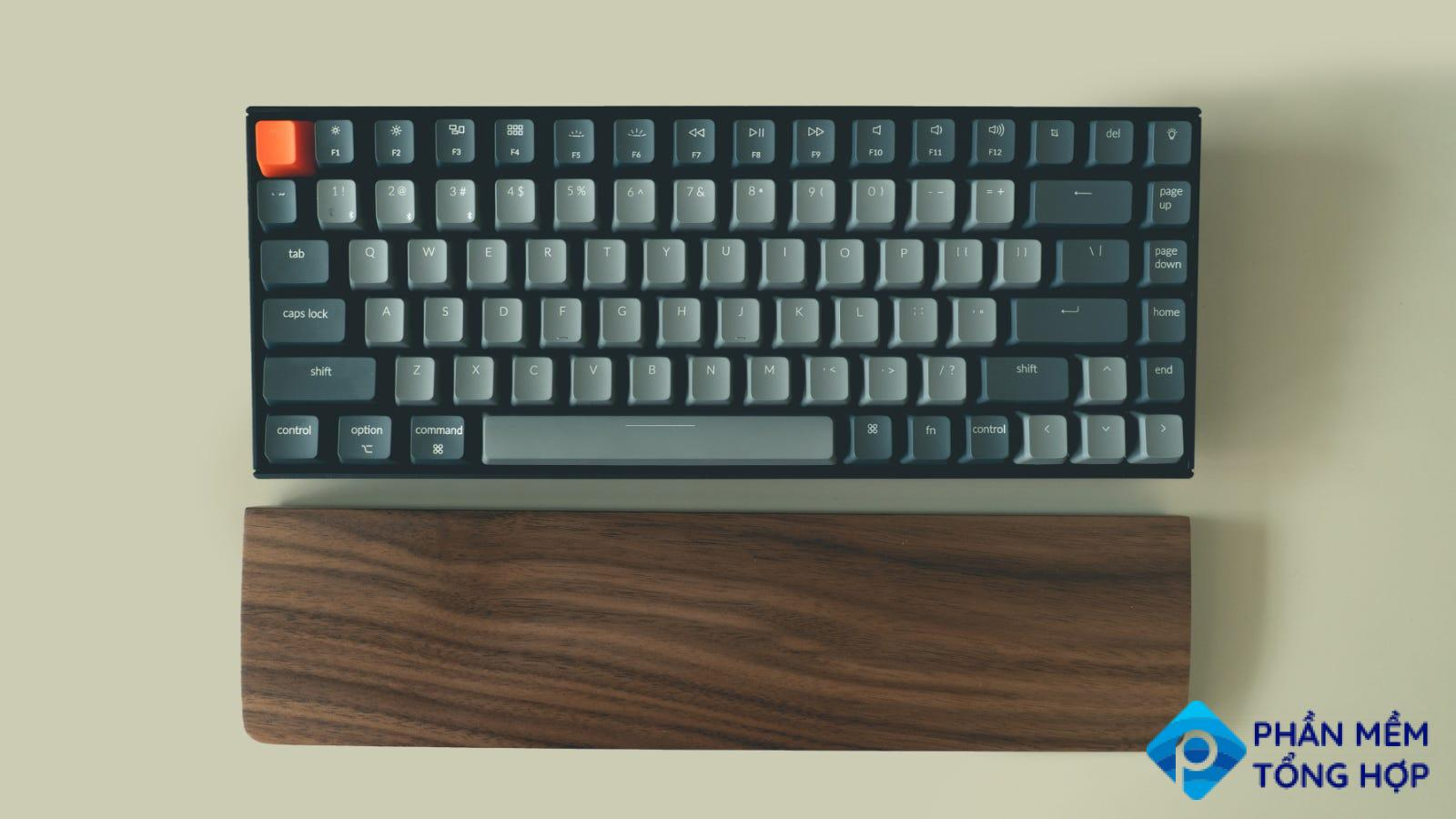 75% mechanical keyboard with a wooden wrist rest