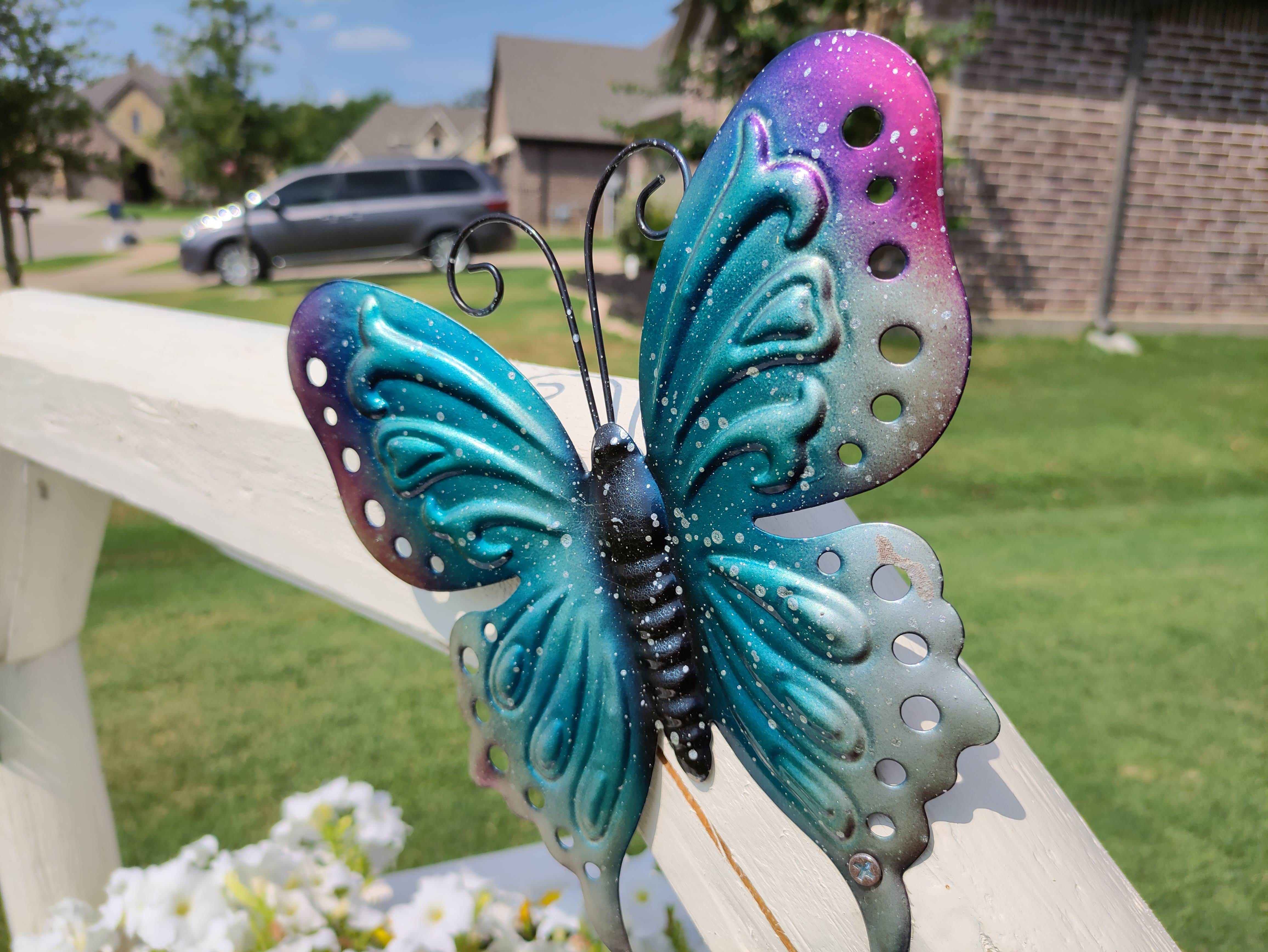 A camera sample with the Red Magic 6R. A colorful metal butterfly.