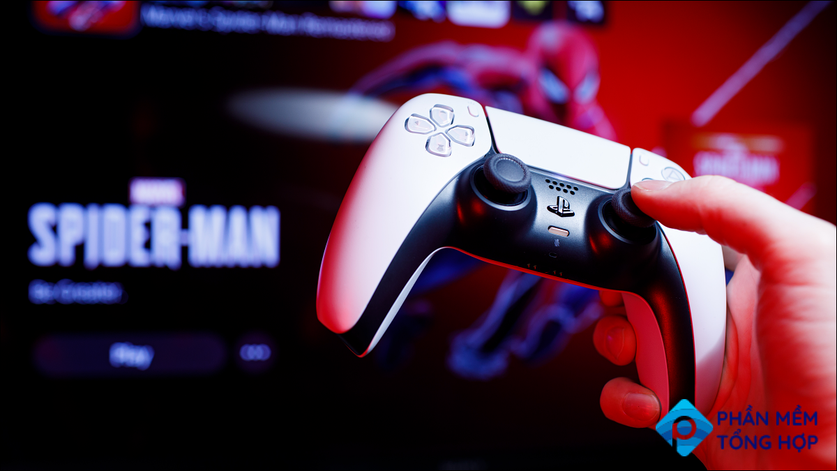 White DualSense Controller in front of Spider-Man game artwork