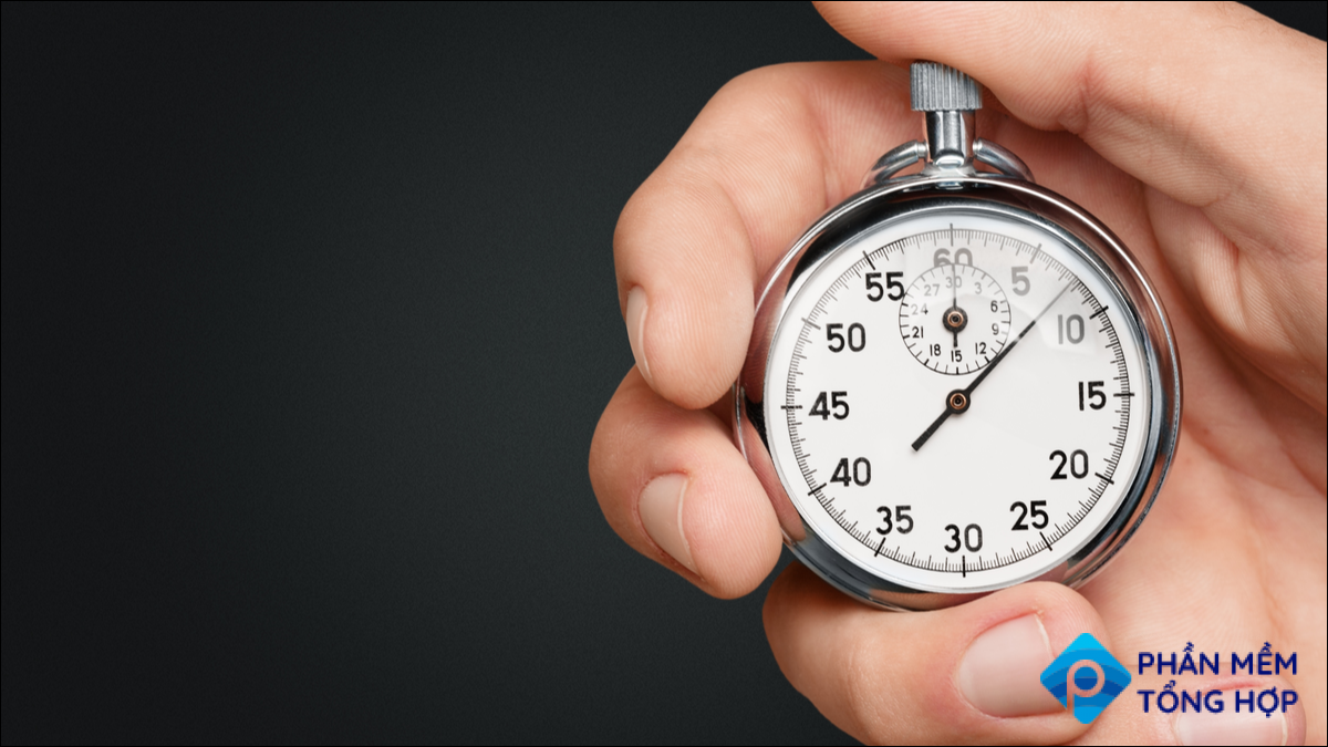A hand holding a stopwatch.