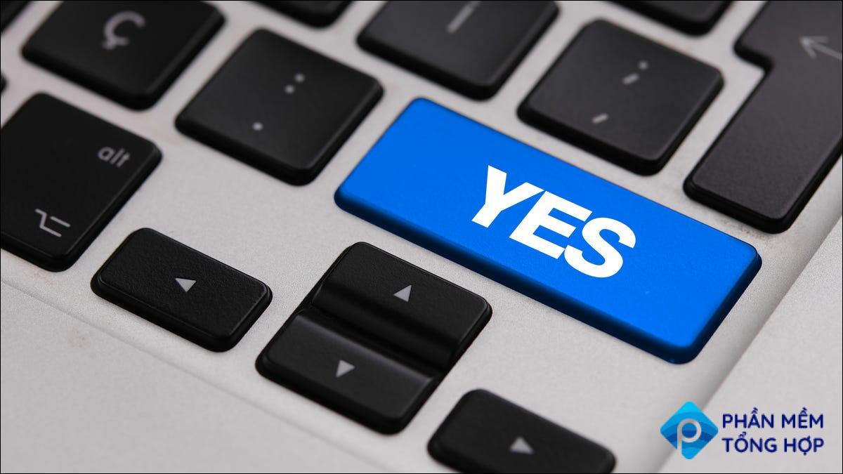 """A big """"Yes"""" button on a MacBook keyboard."""