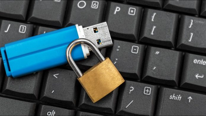 USB drive with a padlock on a computer keyboard
