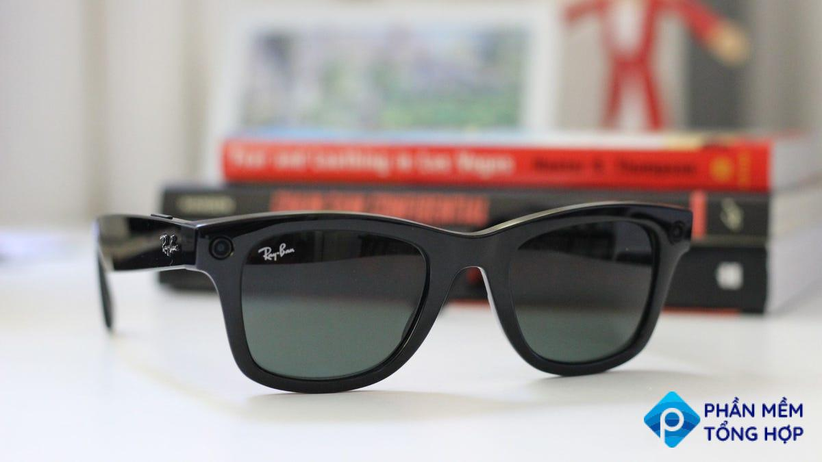 Ray-Ban Stories on a desk, books in the background