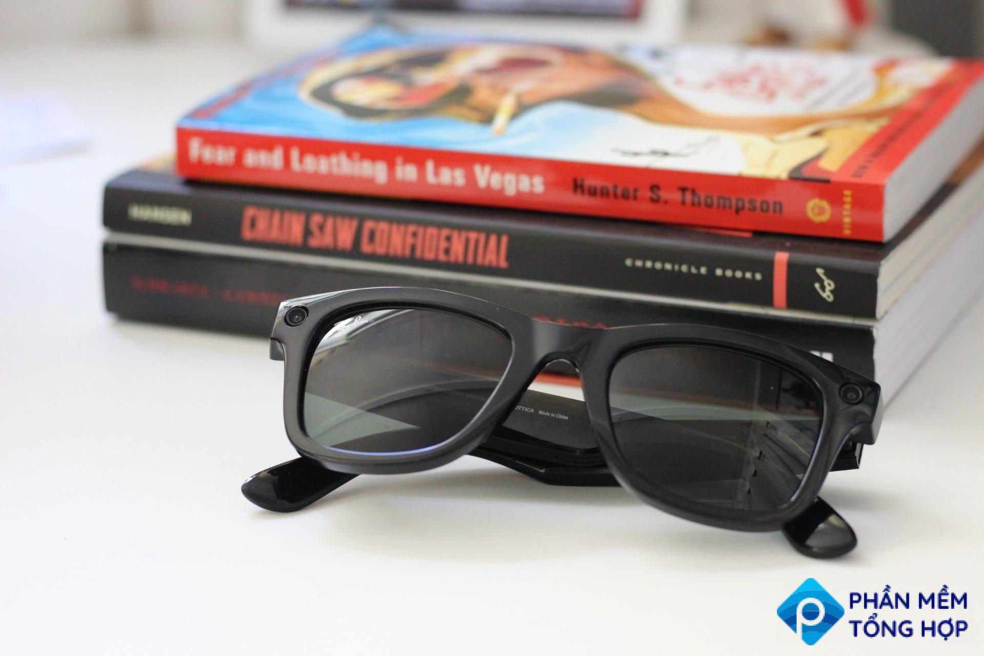 Ray-Ban Stories on a desk in front of some books