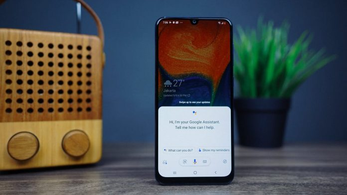 An Android phone with Google Assistant on the screen.
