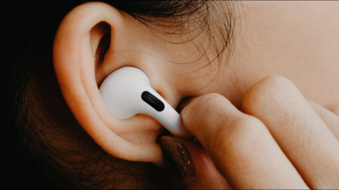 Apple AirPods Pro in a woman's ear