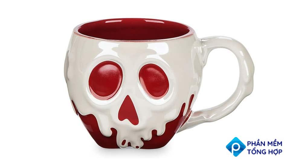 A red and white mug depicting the face of the poisoned apple from Disney's film Snow White and the Seven Dwarves.