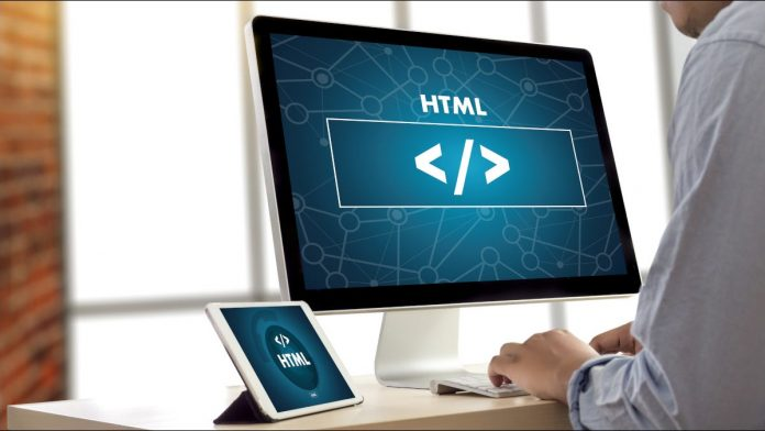 Closeup of computer and tablet screens showing HTML