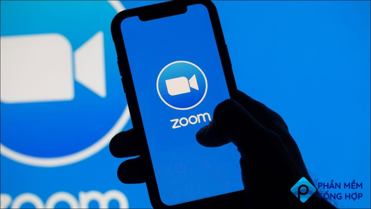 Zoom logo on a smartphone and a computer monitor
